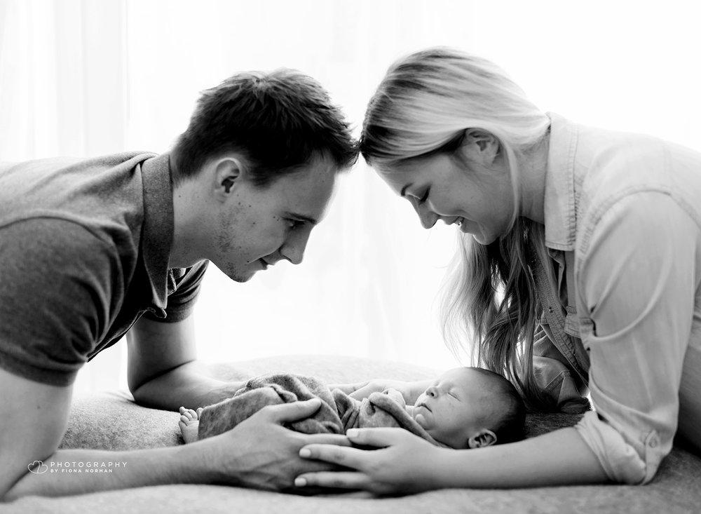 parents_looking_at_baby.jpg