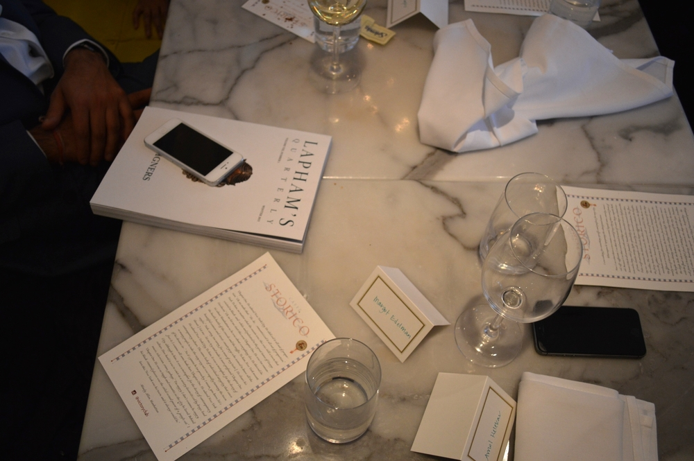 An aerial shot after lunch had been cleared, which included the menus turned over for discussion of the literary passages.