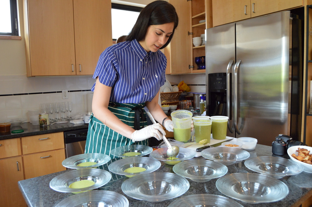 Stephanie Nass plating the asparagus soup