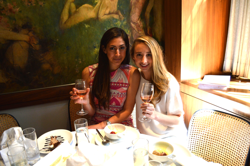 Victory Club founder Stephanie Nass and Victory Club member Clare McLaughlin toasting with rosé
