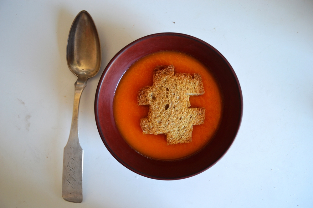 "Carrot soup with a puzzle piece garnish, referencing Anastasi's famous ""Puzzle Puzzle"""