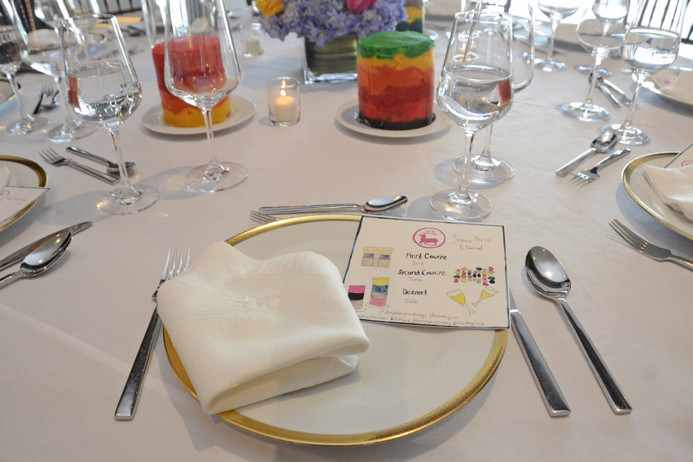 Tablescape at the Avenue Magazine dinner, including with colorful flower arrangements by Mark Masone, cakes inspired by the Seven Magic Mountains, menus painted by Chefanie, and embroidered napkins. Photo credit Lukas Greyson