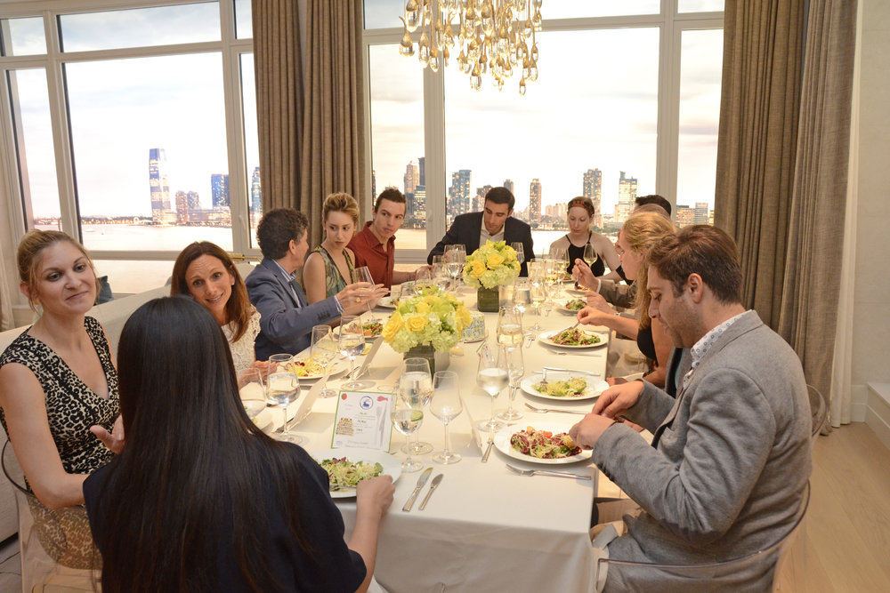 Guests enjoying a sit-down dinner. Credit: Lukas Greyson