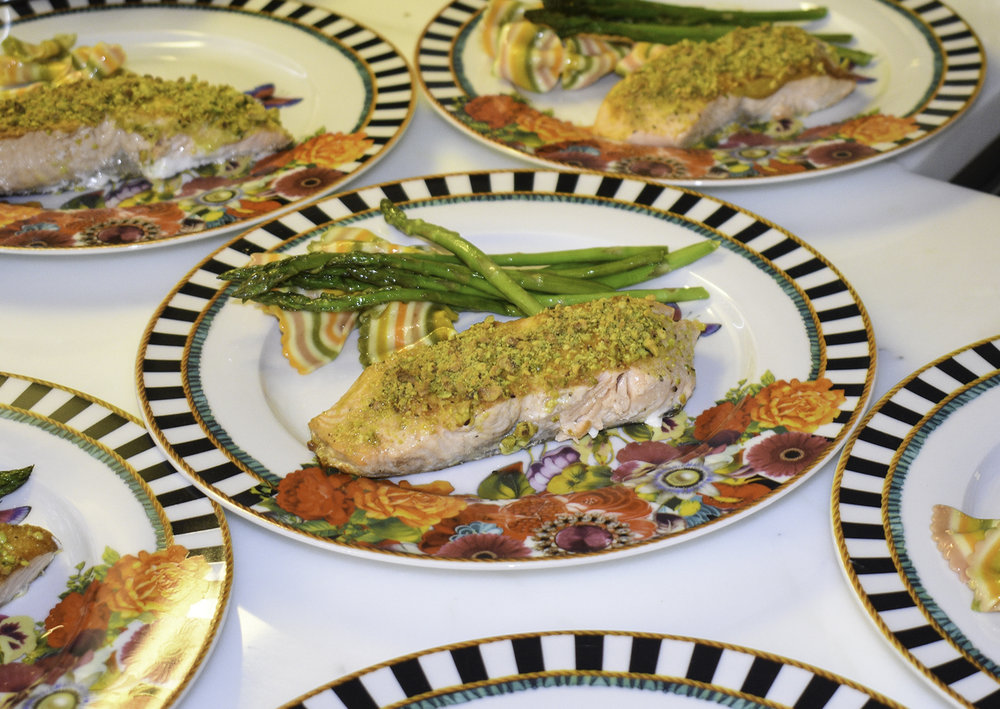 Pistachio Crusted Salmon with asparagus and rainbow butterfly pasta