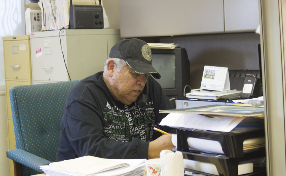 Juan Gonzales at his desk in the City College of San Francisco Journalism Department.