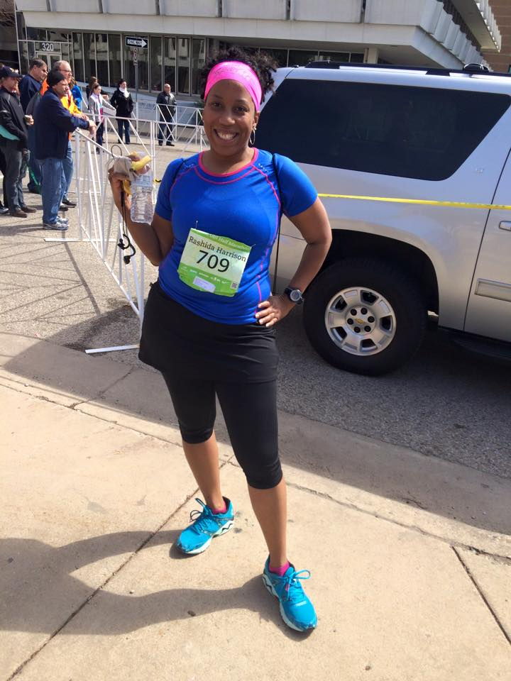 April 2015, after the Gazelle Girls Half Marathon.  Rashida is winning in Mizunos, a headband from hippie runner, a moisture-wicking Smartwool t-shirt, and running skirt from Skirt Sports.