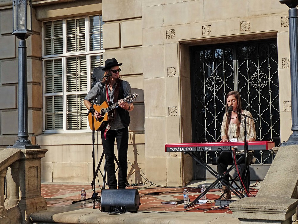 Artists Shane Henry and Maggie McClure perform at the lunch reception at the conference