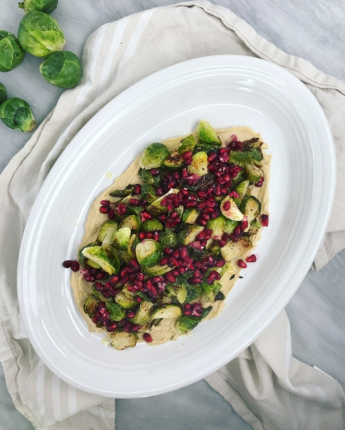 Crispy Brussels with Pomegranate, Lemon and Hummus