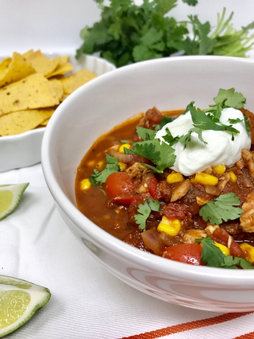 Chicken tortilla soup served with a dollop of Greek yogurt, and fresh cilantro.