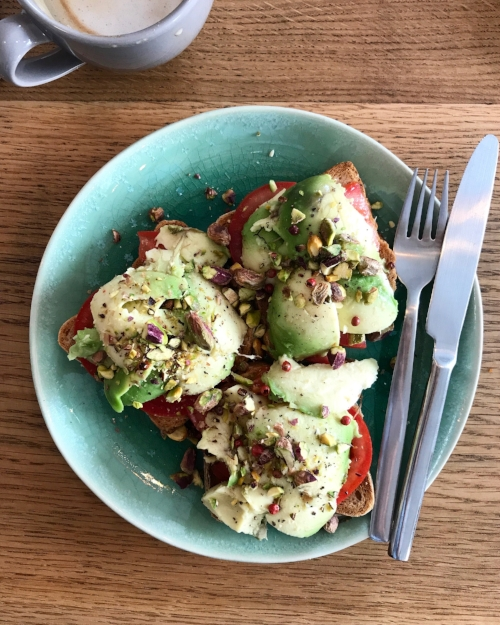 Avocado toast with tomato, crushed pistachios, peppercorns and salt at Hello, Kristof.