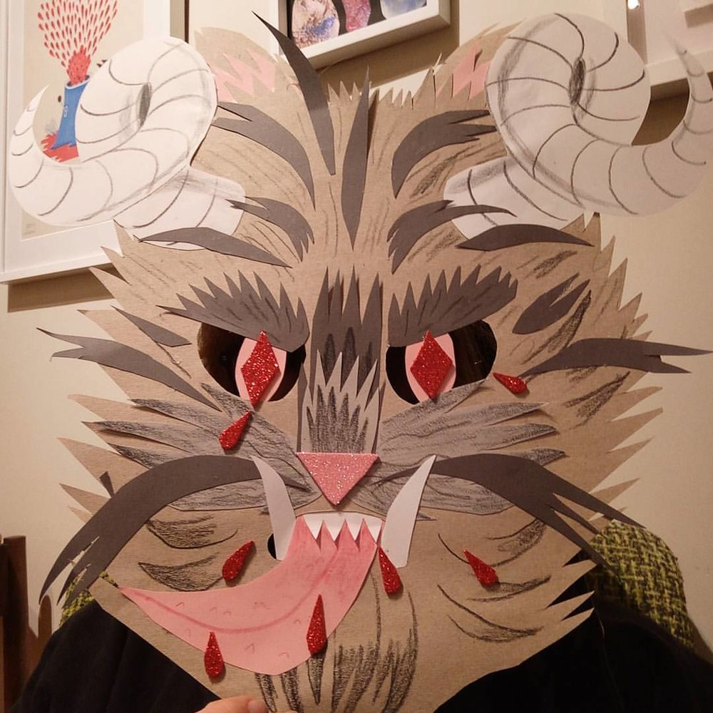 Krampus mask - pencil and coloured pencil on paper and glitter foam.  Personal experimentation / teaching example.