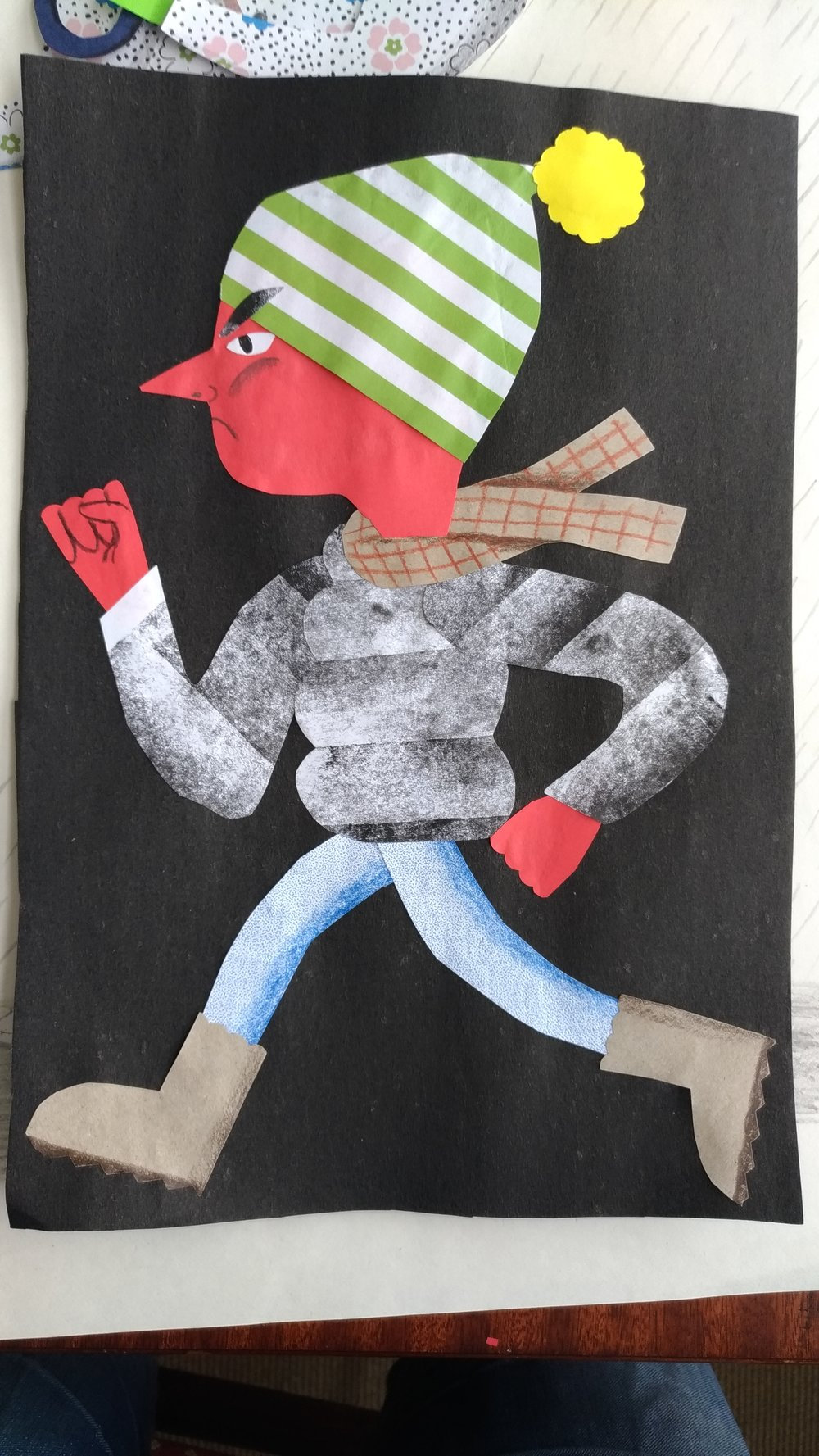 Protester - collage in found paper and pencil.A personal work made as a teaching example