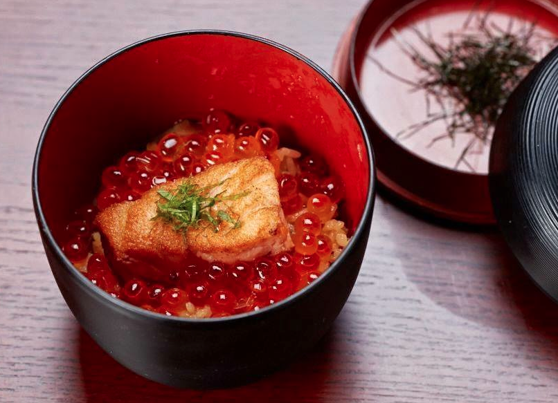 Grilled salmon topped with ikura salmon roe, served over steamed rice infused with burdock and fried-tofu
