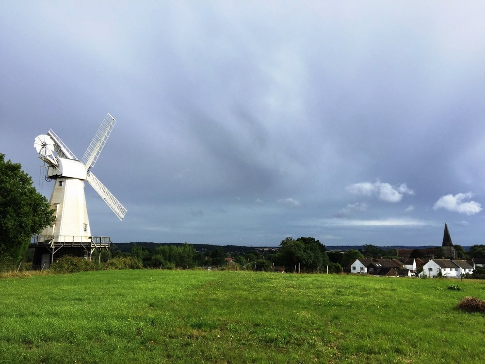 Woodchurch's windmill and church Photo Credit: C Musangi AIA