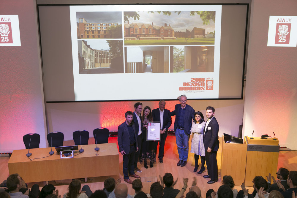 Naill McLaughlin and team accept the Professional Award for West Court Phase 1, Jesus College, with juror Giancarlo Alhadeff, AIA UK President Alex Miller, and AIA UK Vice President Amrita Raja.