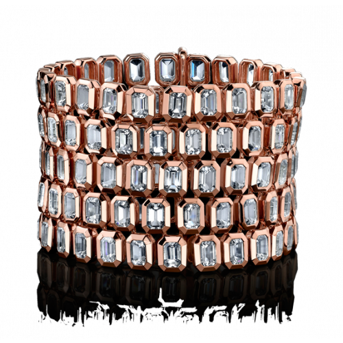 Five Row White Quartz Tablet Bracelet This stunning bracelet is constructed from five rows of white quartz tablet cut stones that stack upon the wrist, creating an elegant cascade down the arm of the wearer.
