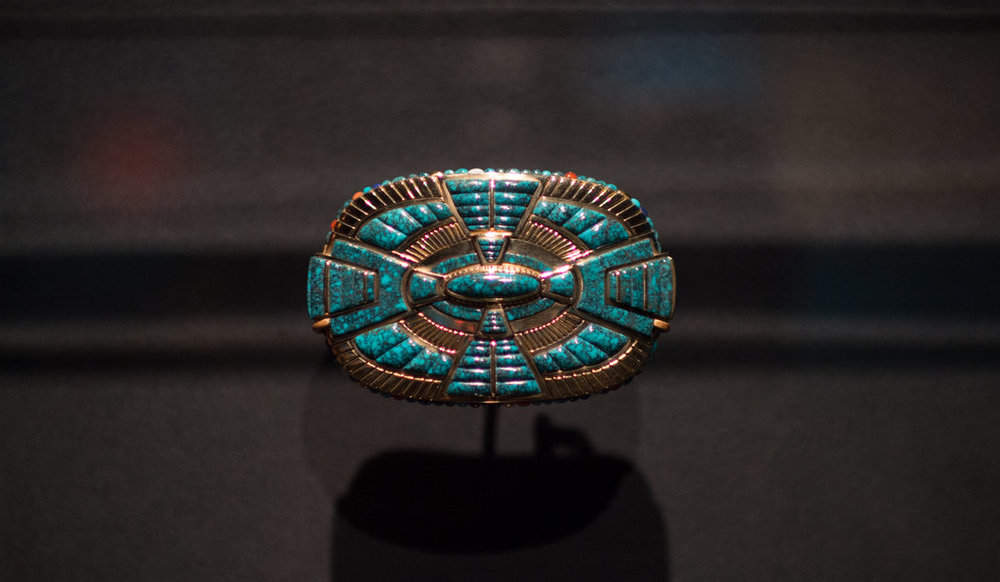 A belt buckle by Lee Yazzie, in Lone Mountain Spider Web turquoise, uses the classic quadrant design of the Navajo. Credit Nancy Borowick for The New York Times
