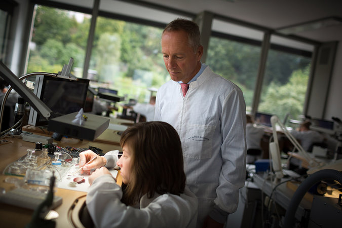 Wilhelm Schmid, chief executive of A. Lange & Söhne, in the chronograph assembly department of the company's new building in Glashütte, Germany. Credit Gordon Welters for The New York Times
