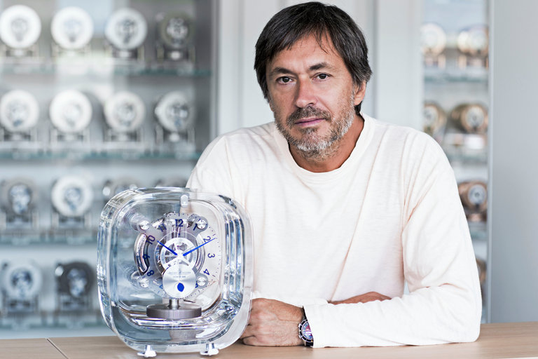 Marc Newson with the new Atmos 568 from Jaeger-LeCoultre. CreditJohann Sauty