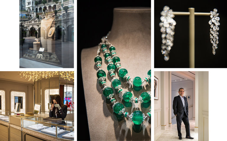 Nirav Modi, lower right, in his recently opened boutique at 1881 Heritage in Hong Kong. Display pieces include the Maharani emerald necklace, center, graduated emerald beads with diamonds, and Luminance Cascade Earrings, upper right, with brilliant-cut, old-cut and jasmine-cut diamonds.CreditPhotographs by Billy H.C. Kwok for The New York Times