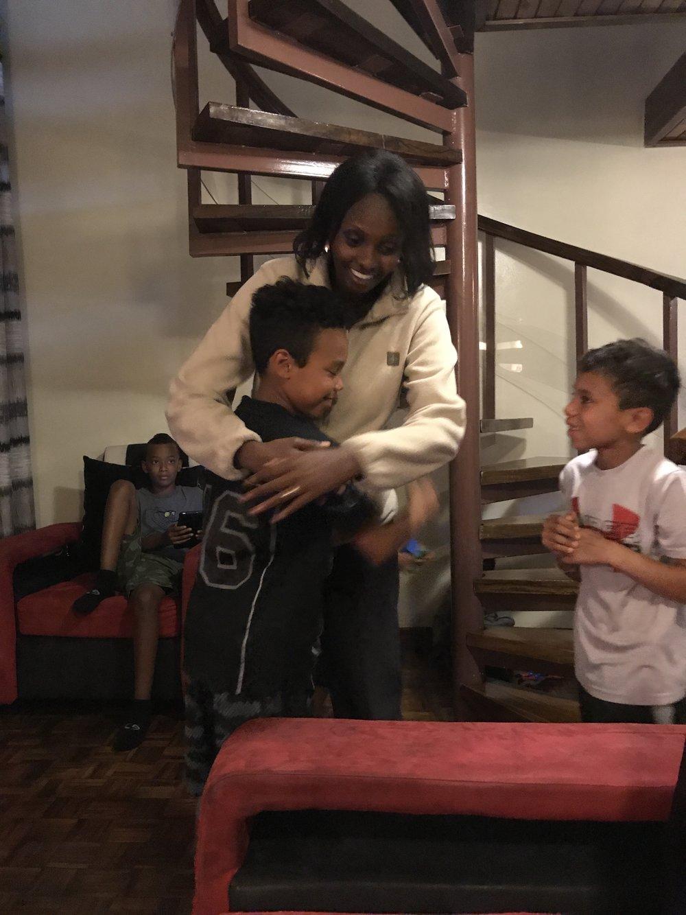 Wambui Greeting The Boys