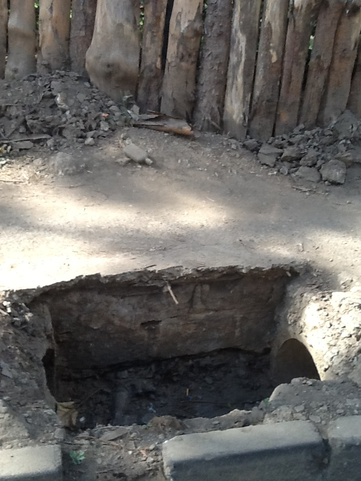 Open hole in the sidewalk