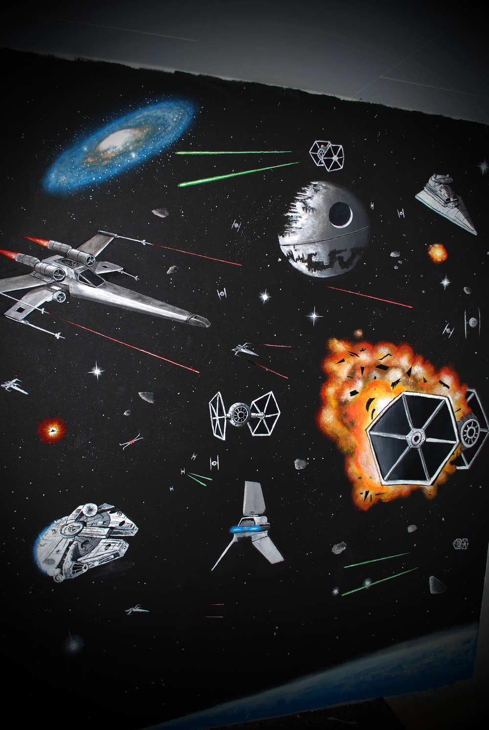 i was commissioned to paint this mural in a bedroom of a star wars fan
