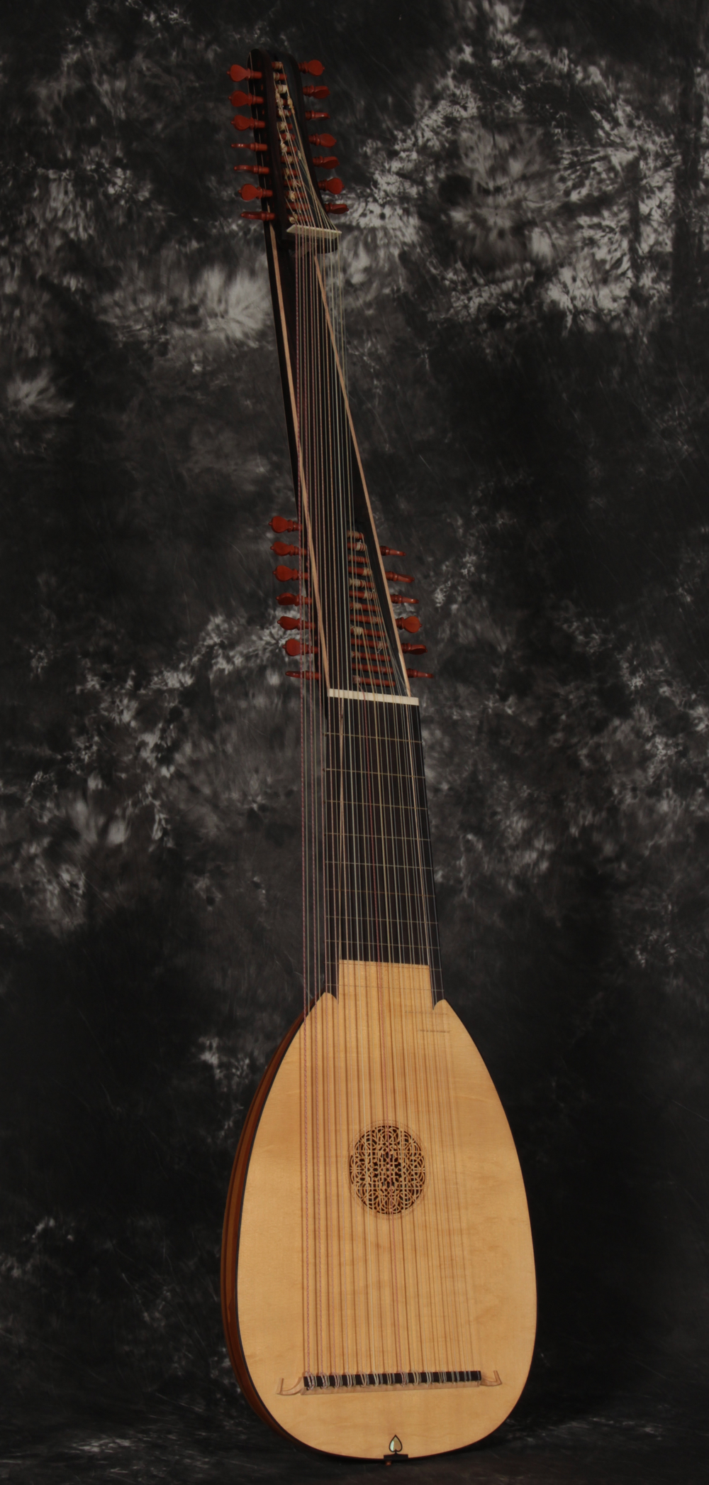 A liuto attiorbato with a Venere model, 61cm body and 120cm extension, fourteen double courses. Twenty one shaded yew ribs, Italian Alpine figured spruce front, ebony veneered neck and extension.