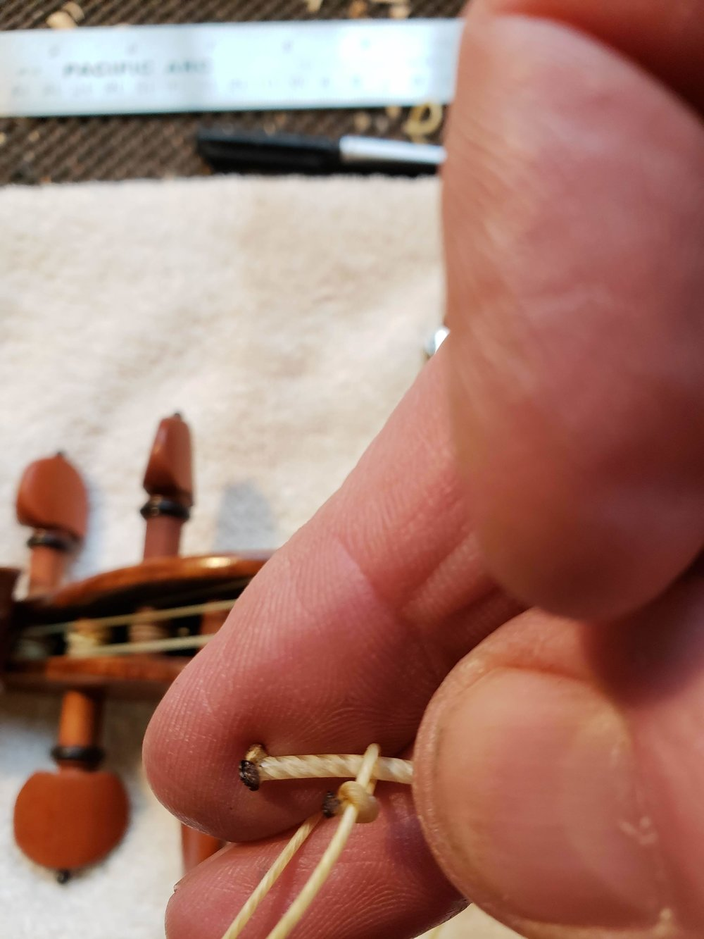 Step 11 - You now have a slip-knot that you can put over the end of the playing string.
