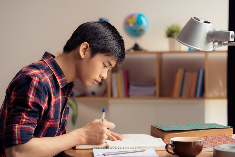 Asian Guy Studying.jpg
