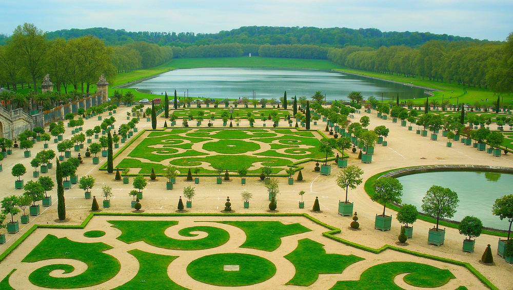 Intricately shaped and mowed lawns of the Orangerie in the Palace of Versailles.