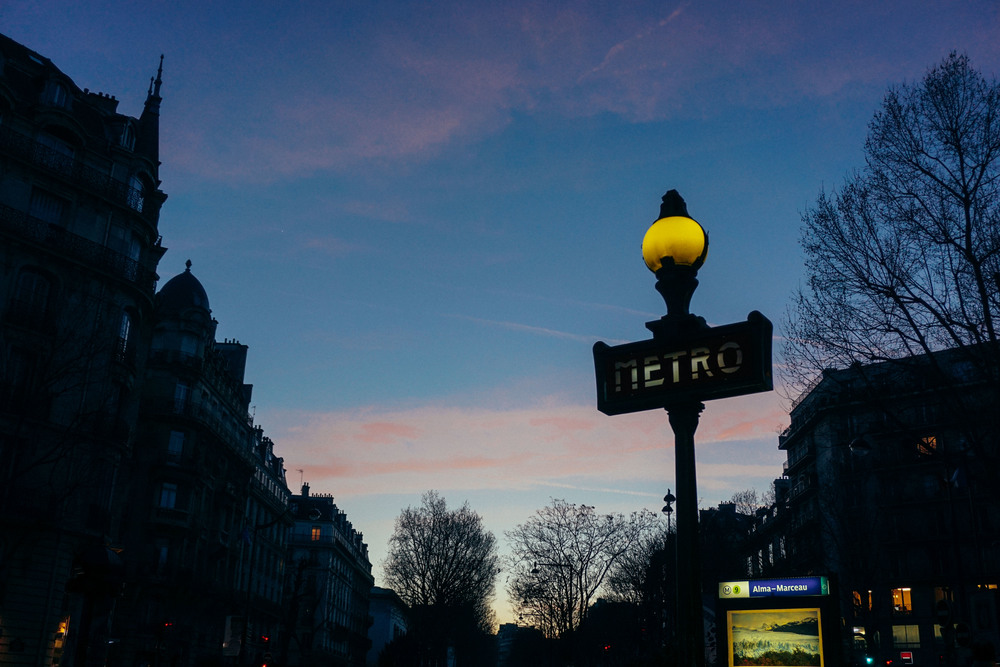 Metro sign in Paris at sunset