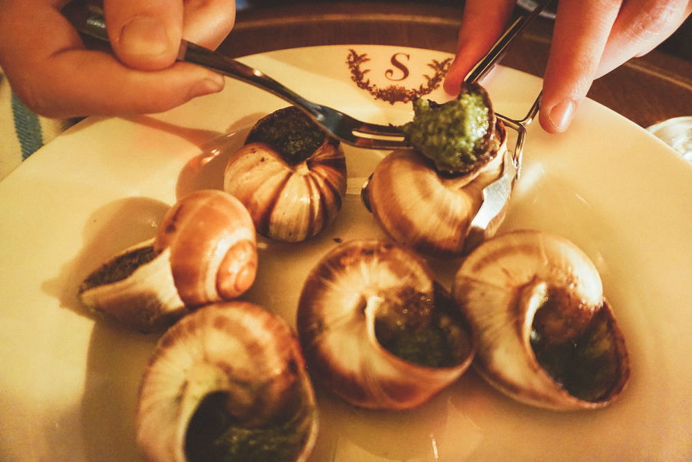 Eating garlic snails at Le Scossa restaurant in Paris
