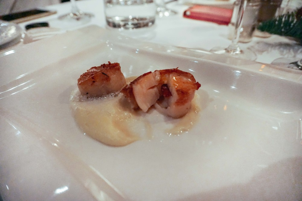 Christmas Dinner. Scallops stuffed with parma ham on bisque.