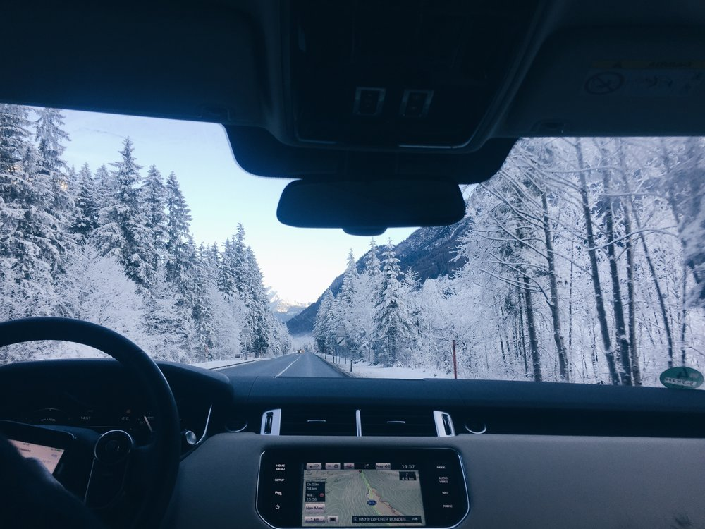Range Rover driving through the snowy Alps