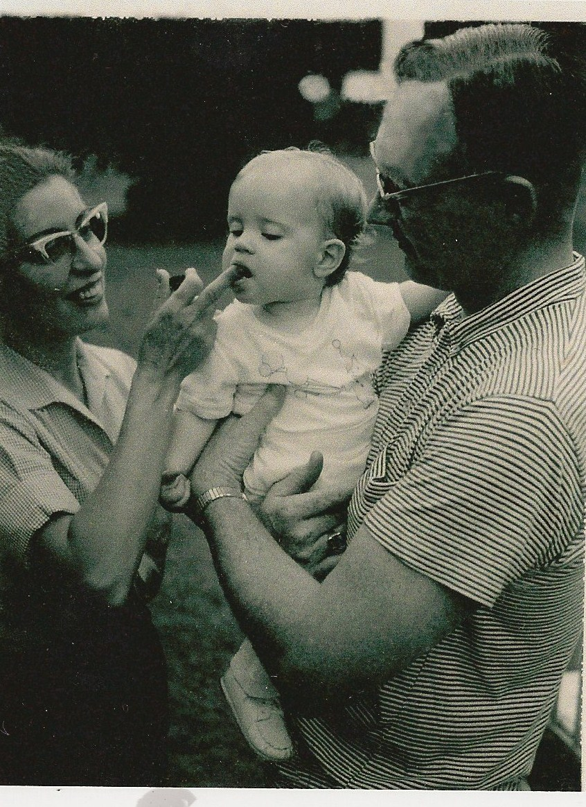 me with my parents on my 1st birthday