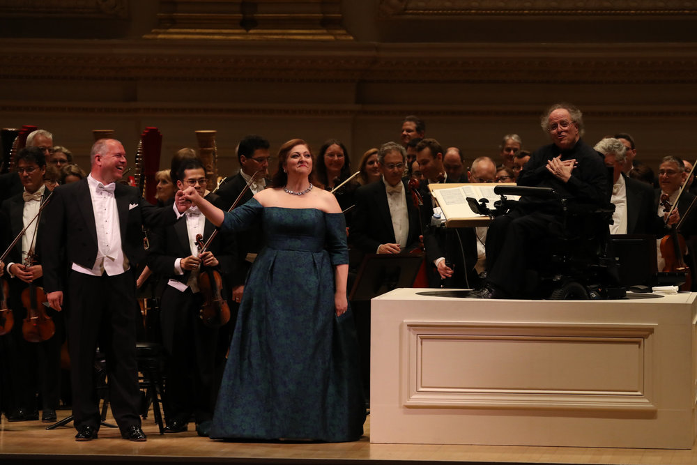 Stefan Vinke, far left; Christine Goerke, center; and, far right, the conductor James Levine, with the Met Orchestra at Carnegie Hall   (Photo: New York Times )