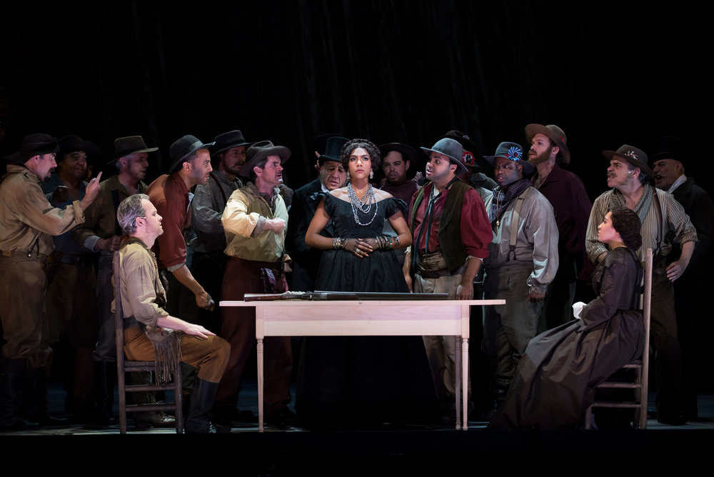Ryan McKinny as Clarence, J'Nai Bridges as Josefa Segovia, Julia Bullock as Dame Shirley, and the San Francisco Opera Chorus.  Photo: Stefan Cohen
