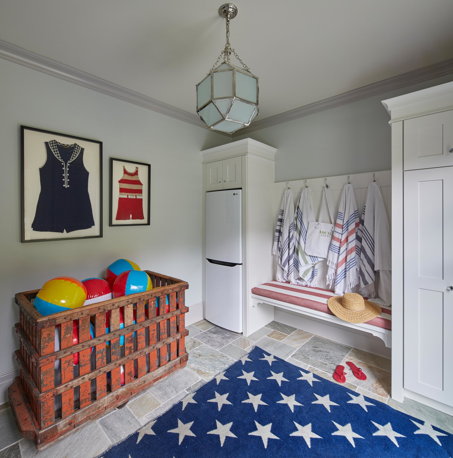 Cheerful red, white and blue pool cabana or mud room with star rug. Come see more interior design inspiration from Elizabeth Drake. Photo by Werner Straube. #interiordesign #classicdesign #traditionaldecor #housetour #elizabethdrake