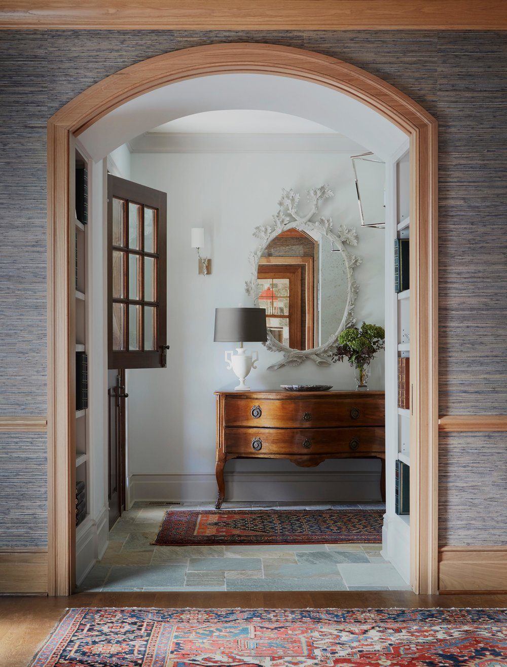 Entry with dutch door, stone floor, and antiques. Come see more interior design inspiration from Elizabeth Drake. Photo by Werner Straube. #interiordesign #classicdesign #traditionaldecor #housetour #elizabethdrake
