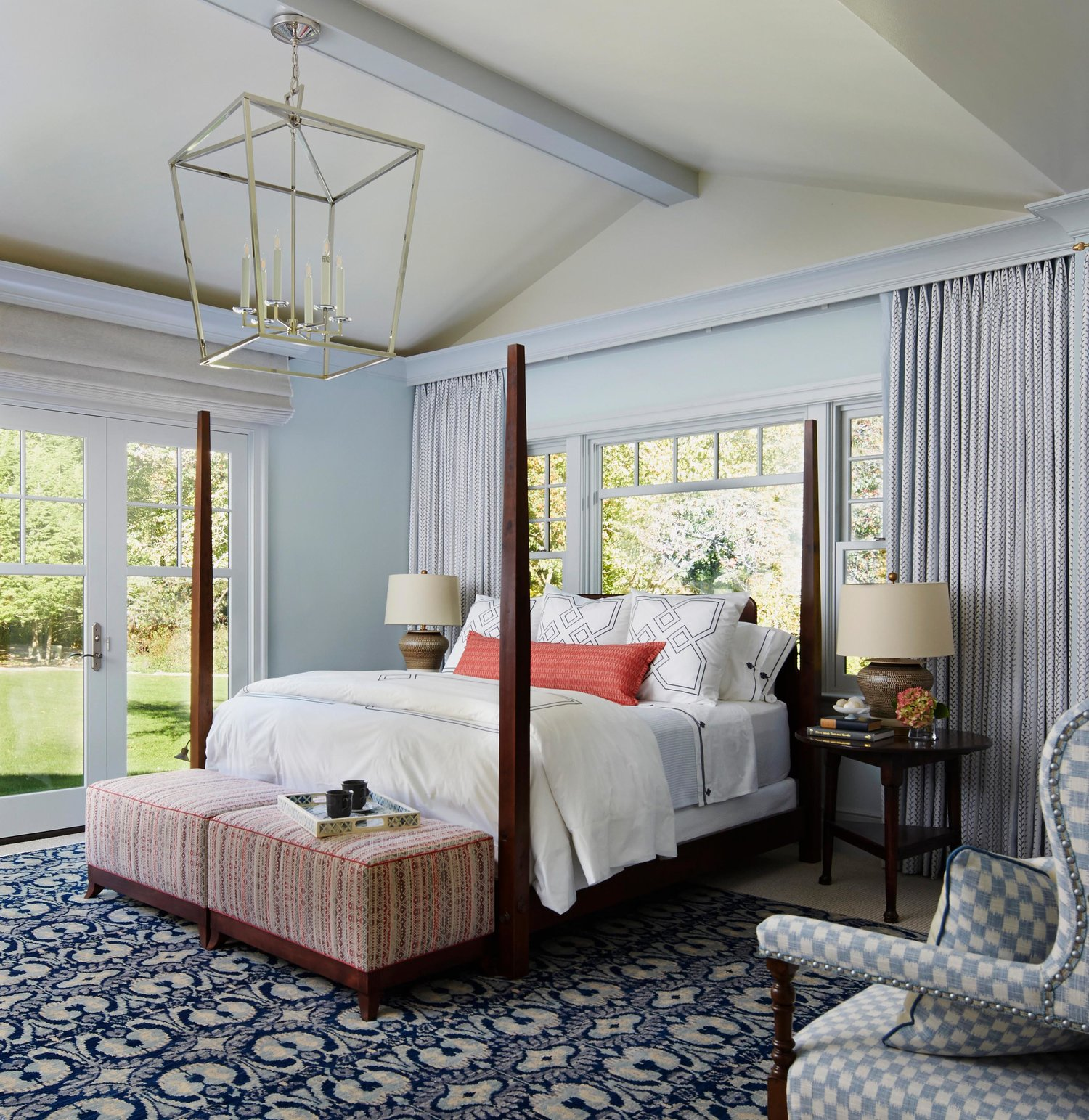 Traditional style bedroom with blue and pops of coral. Come see more interior design inspiration from Elizabeth Drake. Photo by Werner Straube. #interiordesign #classicdesign #traditionaldecor #housetour #elizabethdrake