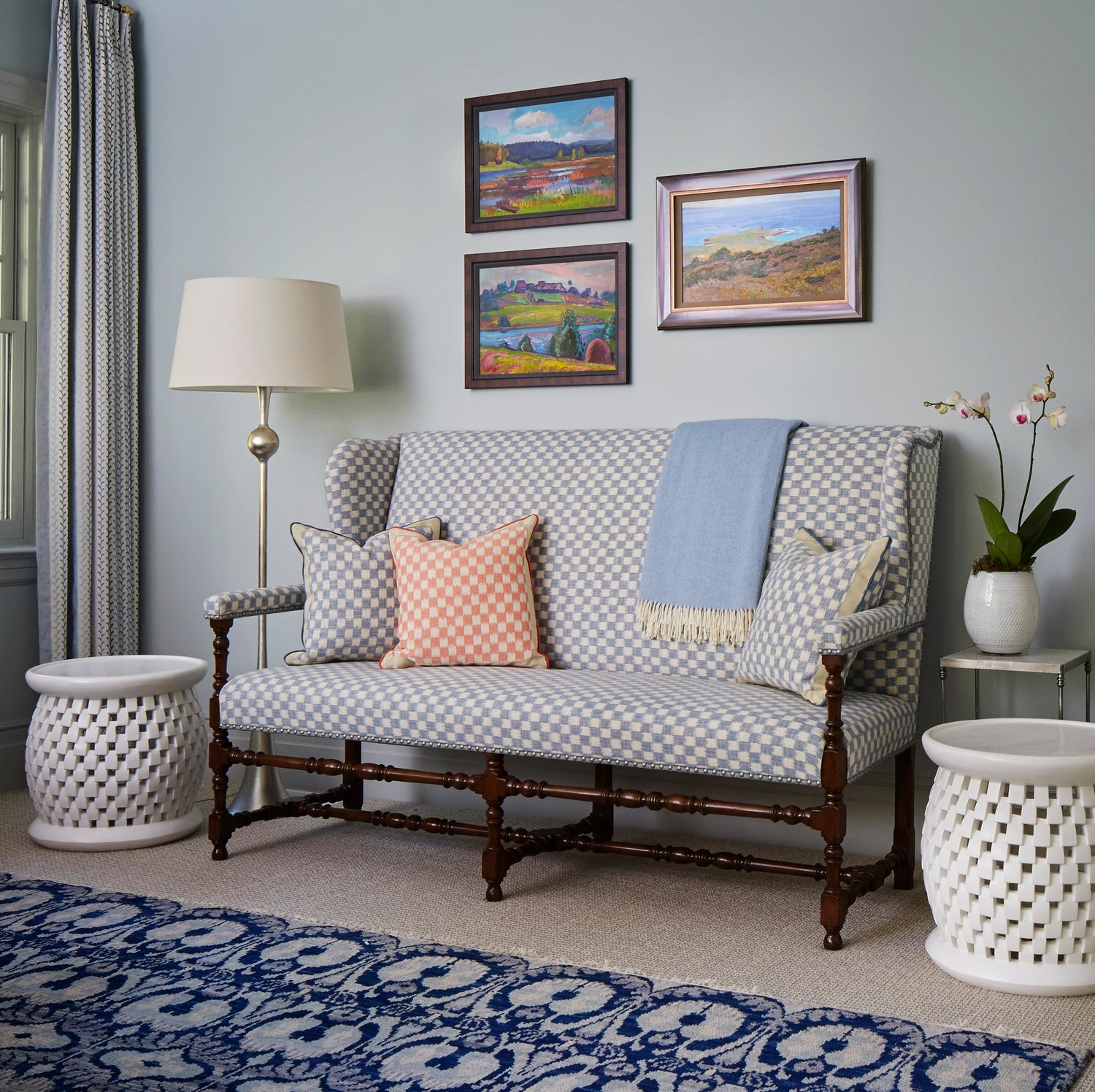 Charming check on a settee in a blue bedroom. Come see more interior design inspiration from Elizabeth Drake. Photo by Werner Straube. #interiordesign #classicdesign #traditionaldecor #housetour #elizabethdrake
