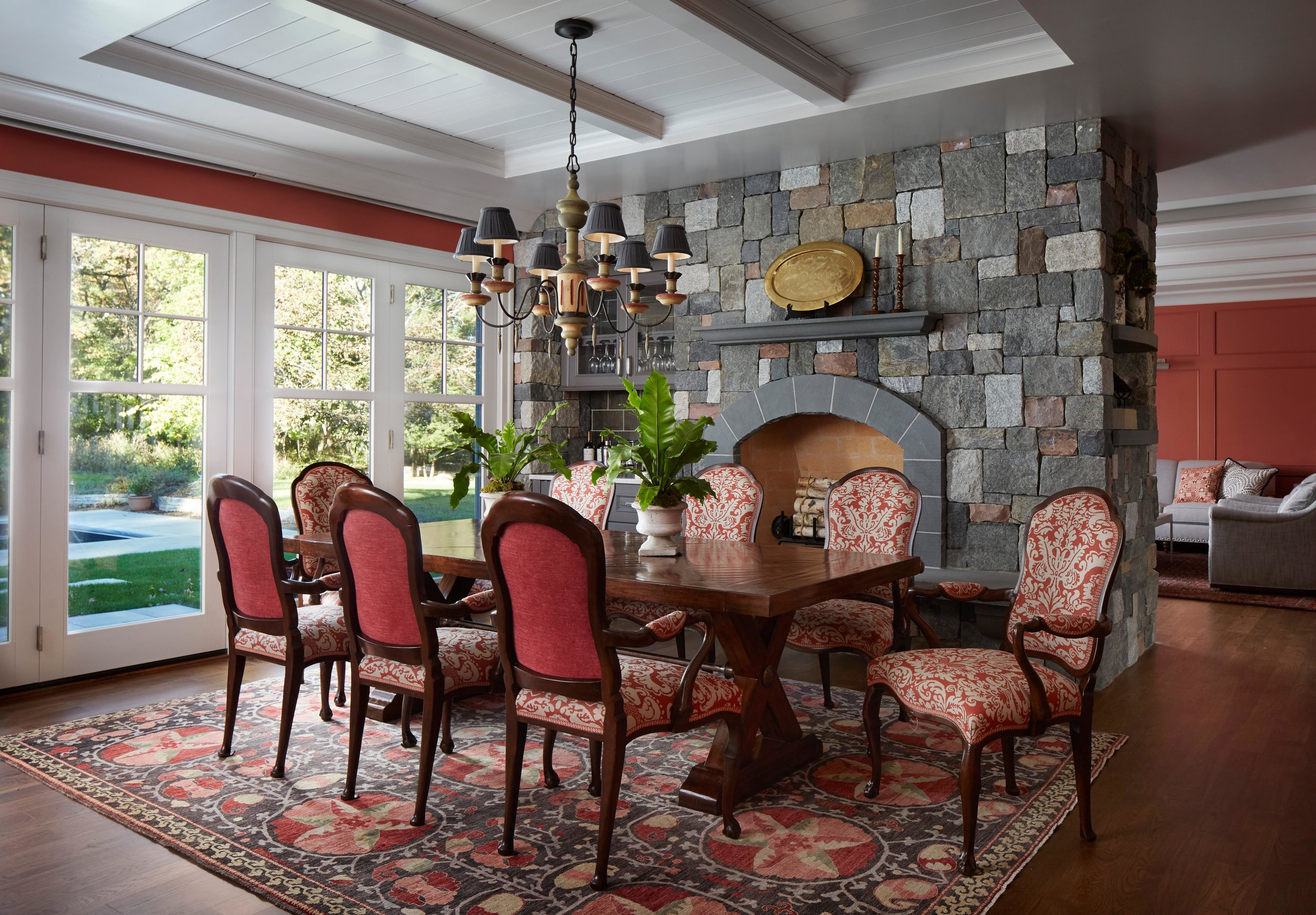 Coral walls and accents in a classic dining room with fireplace. Come see more interior design inspiration from Elizabeth Drake. Photo by Werner Straube. #interiordesign #classicdesign #traditionaldecor #housetour #elizabethdrake