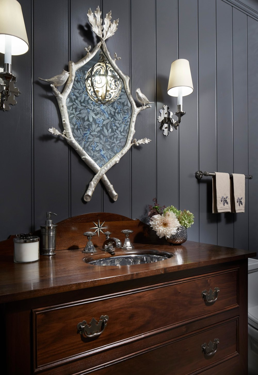 Rich dark painted paneling and wood vanity in a bathroom. Come see more interior design inspiration from Elizabeth Drake. Photo by Werner Straube. #interiordesign #classicdesign #traditionaldecor #housetour #elizabethdrake