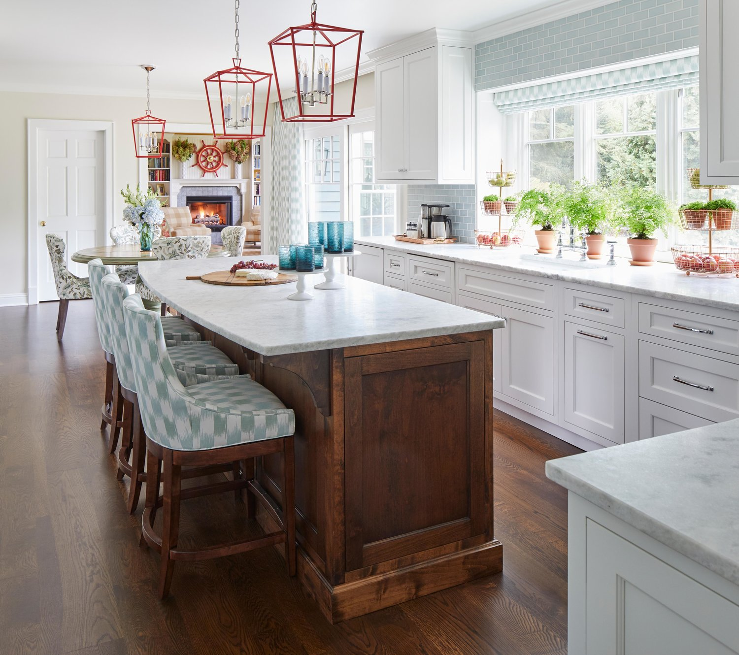 Classic white kitchen with light blue accents, wood island, and coral lantern pendant lighting. Design by Elizabeth Drake. Photo by Werner Straube. #kitchendesign #blueandwhite #classicdesign #traditionaldecor #whitekitchen #interiordesign