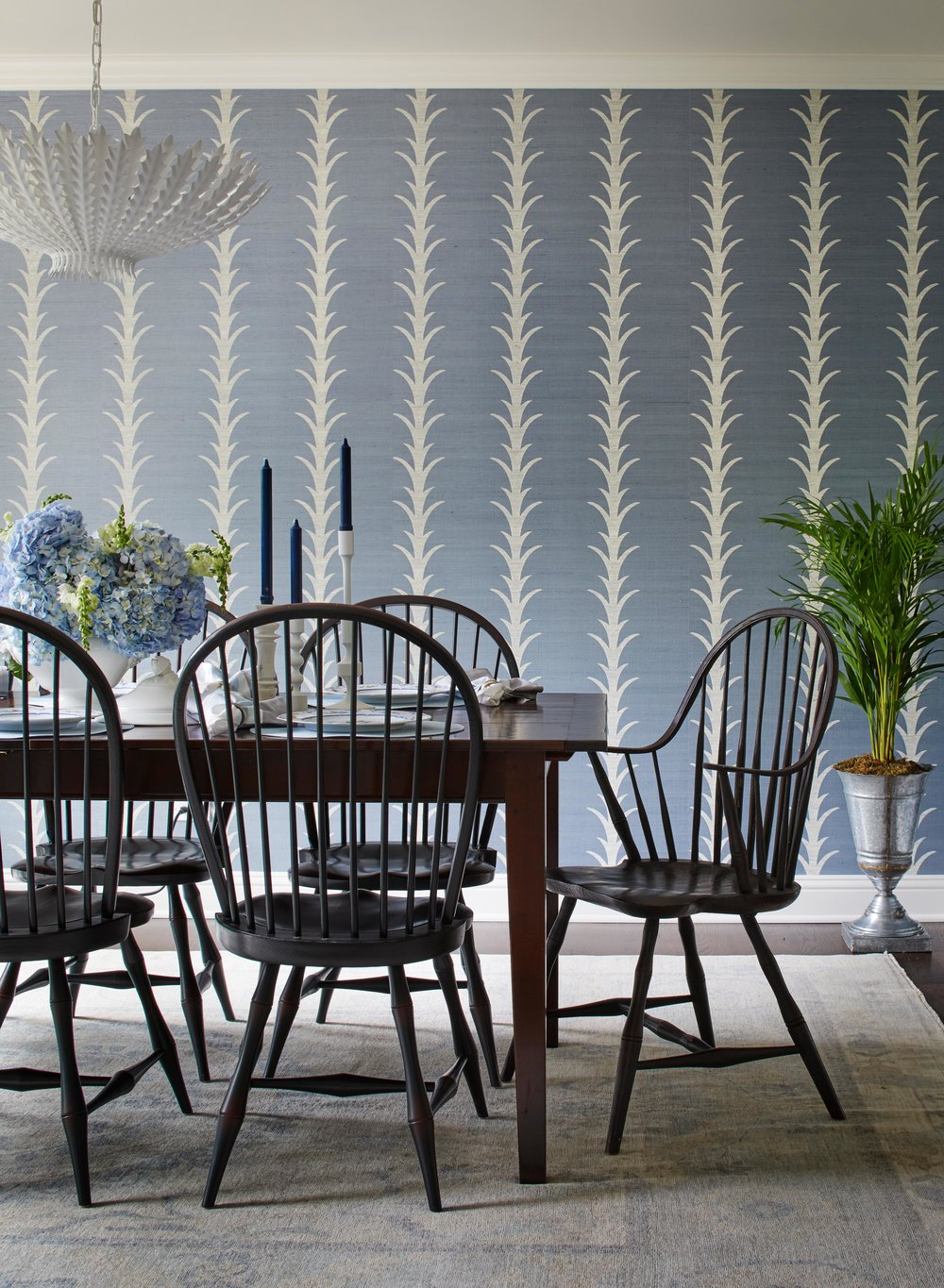 Acanthus motif and blue wallpaper in a classic dining room. Come see more interior design inspiration from Elizabeth Drake. Photo by Werner Straube. #interiordesign #classicdesign #traditionaldecor #housetour #elizabethdrake