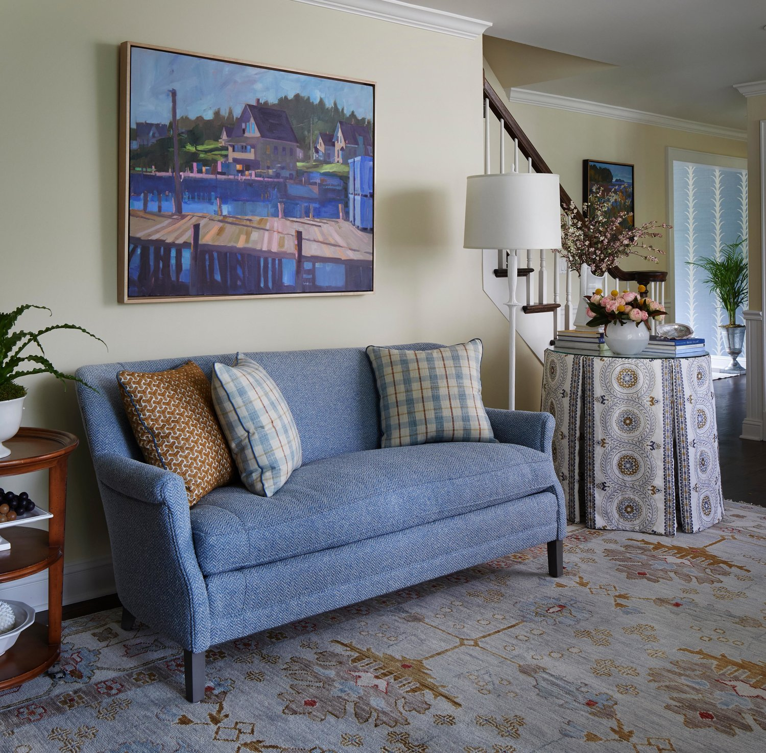 Traditional living room with blue loveseat. Come see more interior design inspiration from Elizabeth Drake. Photo by Werner Straube. #interiordesign #classicdesign #traditionaldecor #housetour #elizabethdrake