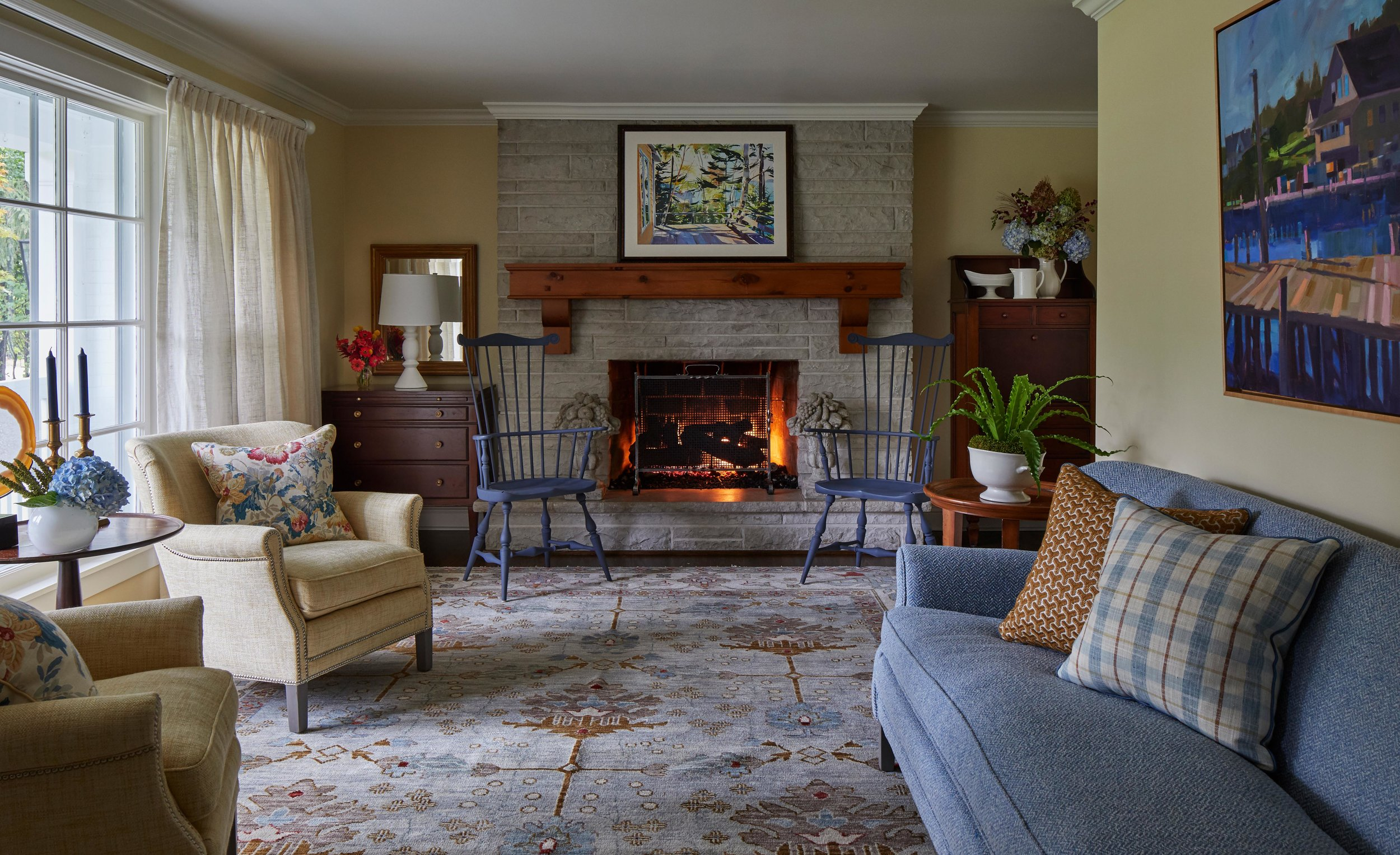 Classic living room with cozy fireplace and blue accents. Come see more interior design inspiration from Elizabeth Drake. Photo by Werner Straube. #interiordesign #classicdesign #traditionaldecor #housetour #elizabethdrake
