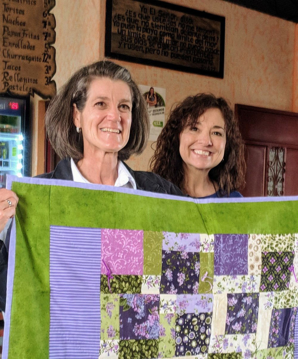 Rev. Mary Cox presenting Pam Nunez with a prayer quilt from RPC's Prayers & Squares ministry during the 2018 Guatemala Mission Experience.