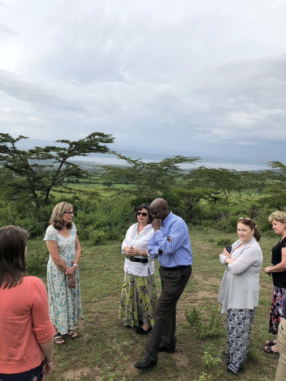 Zablon showing R.O.C.K. Bridge's new property that overlooks Lake Nakuru.